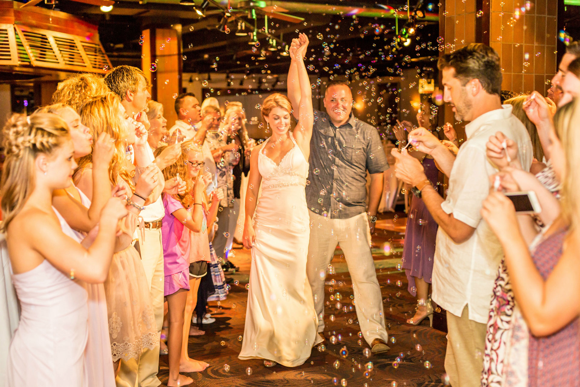 bride and groom being showered in confetti by wedding guests