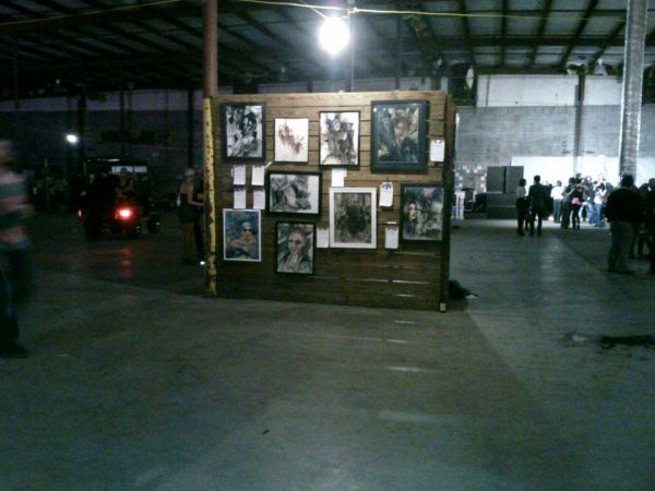 warehouse with art in the background