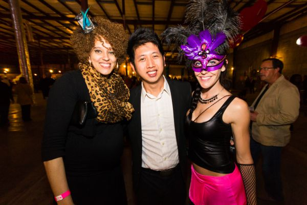 man and two women in costume at art party