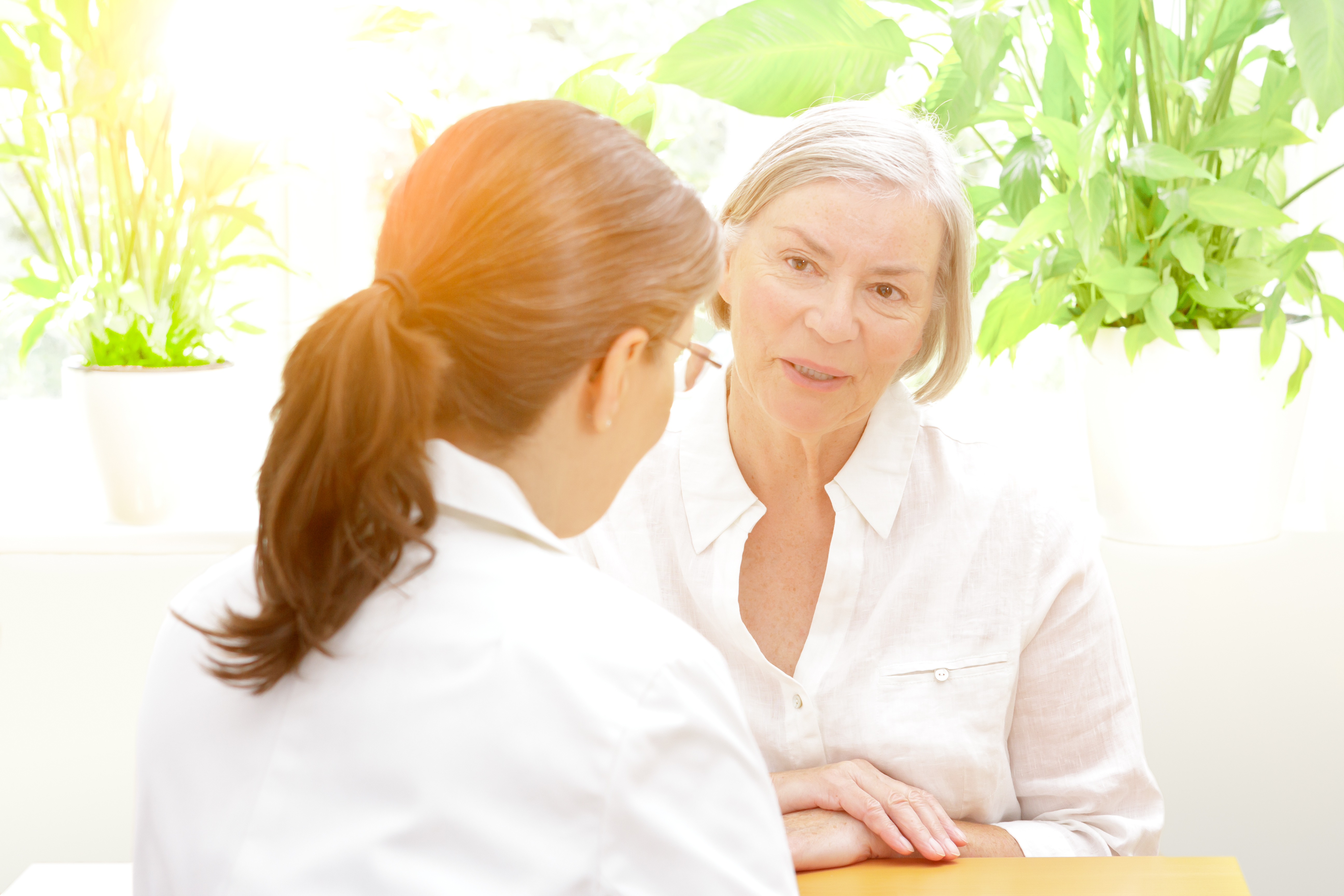 older patient talking with healthcare professional