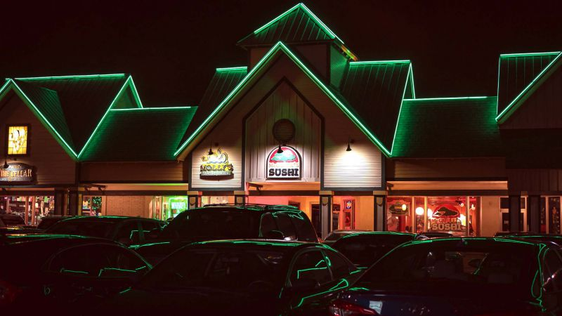 nighttime exterior view of front of McGuire's Sushi