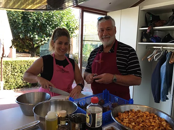 man and woman learning french cooking