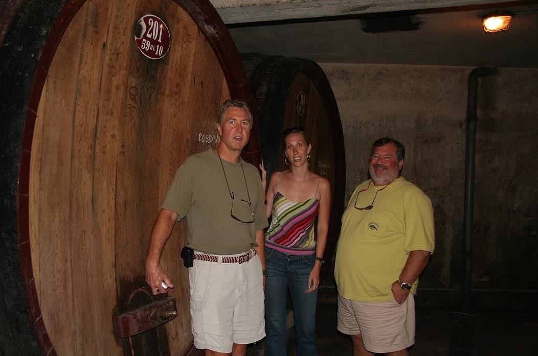 tour participants standing beside a huge barrel