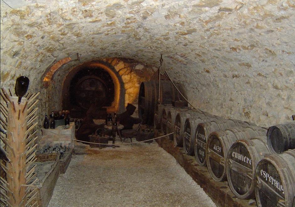large barrels of alcohol stored underground