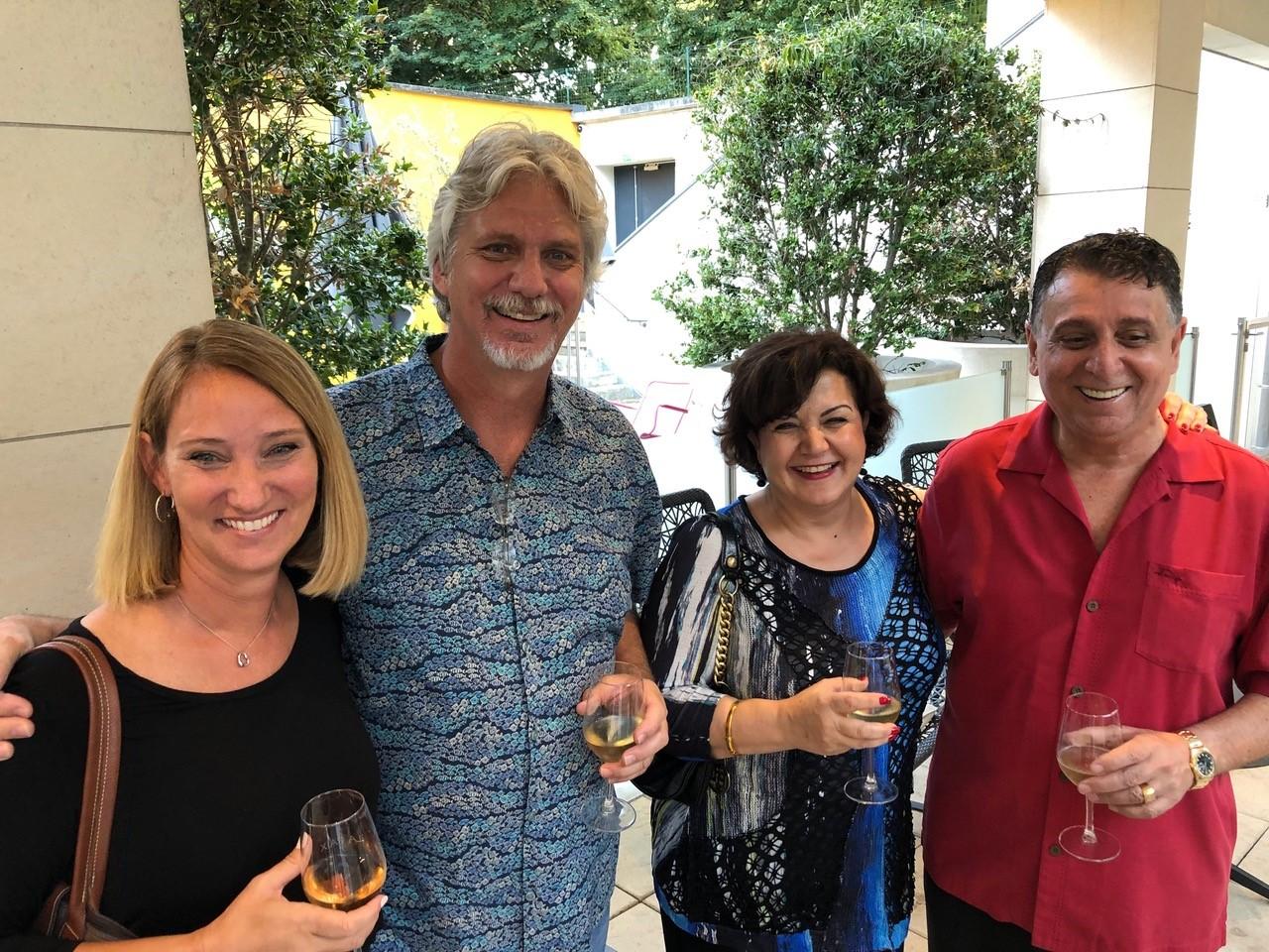 Guests posing at wine tasting
