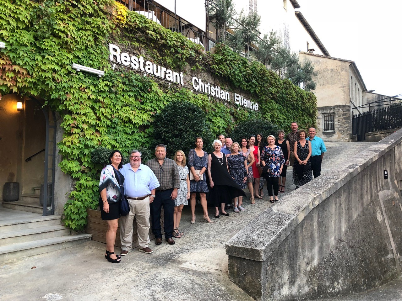 Guests taking group photo in front of a restaurant