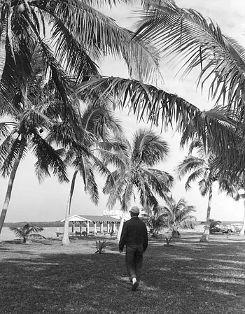 a man walking along Olde Marco Island