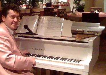 Dan Vass at a piano