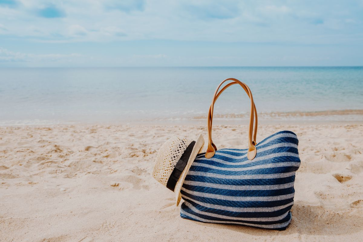 Blue beach bag on sand