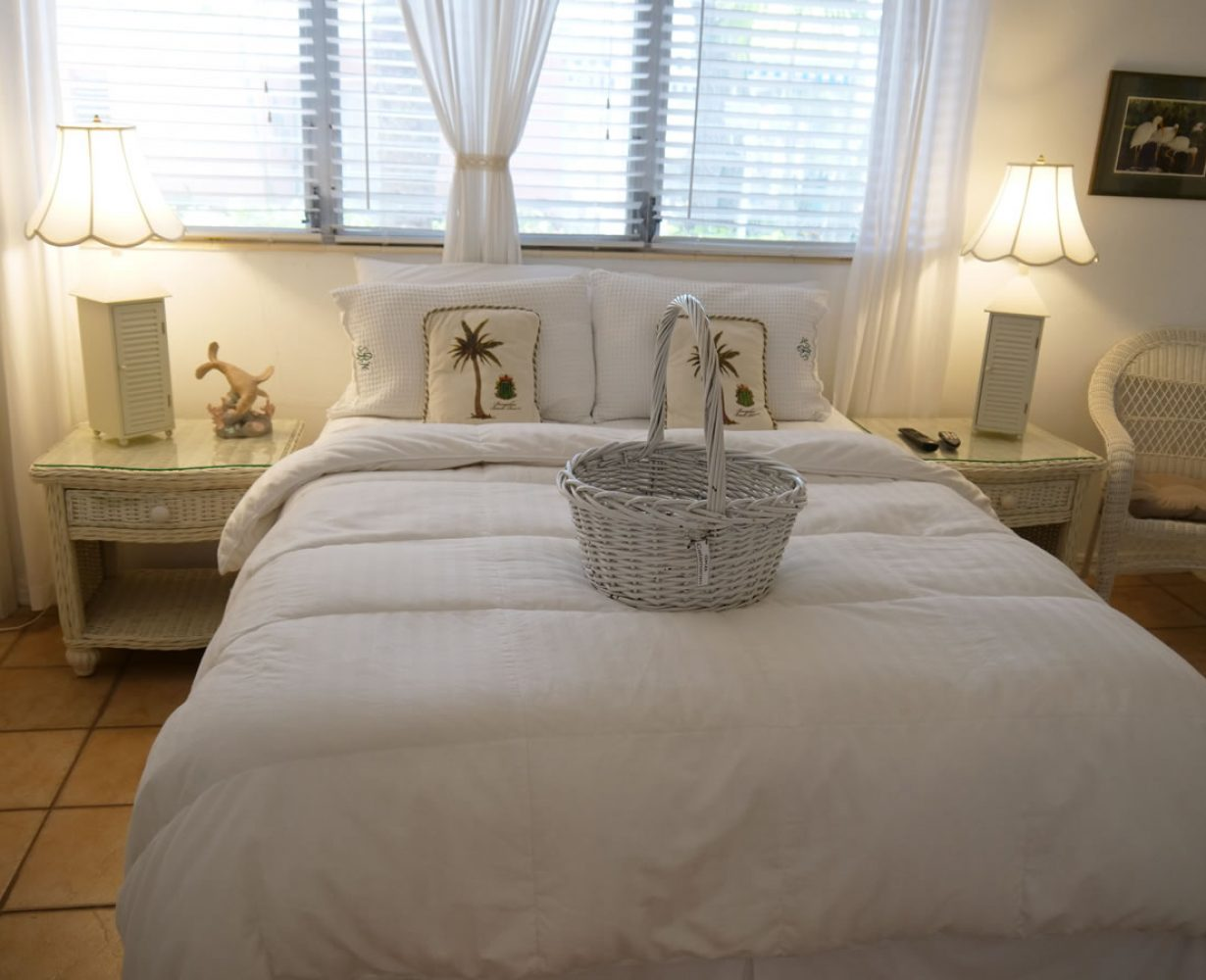 Bedroom straight view with basket on bed