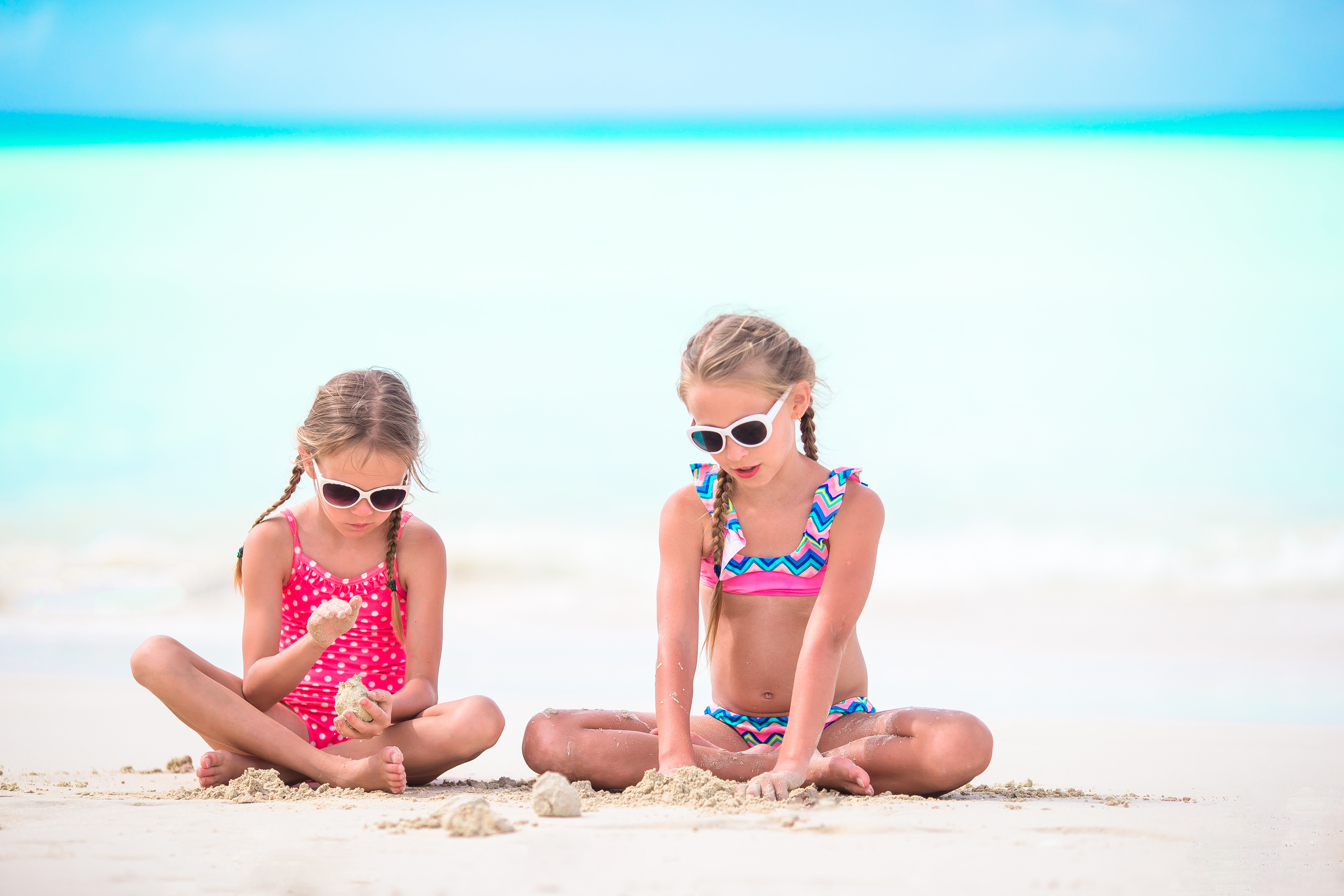 Siesta Key Bungalows Two Little Happy Girls at the Beach in the Sand