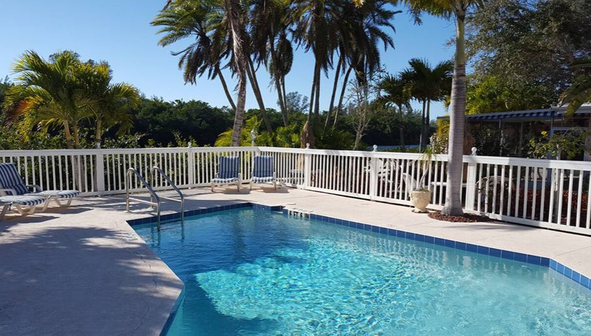 Alternate view of pool area at Siesta Key Bungalows featuring the outdoor pool