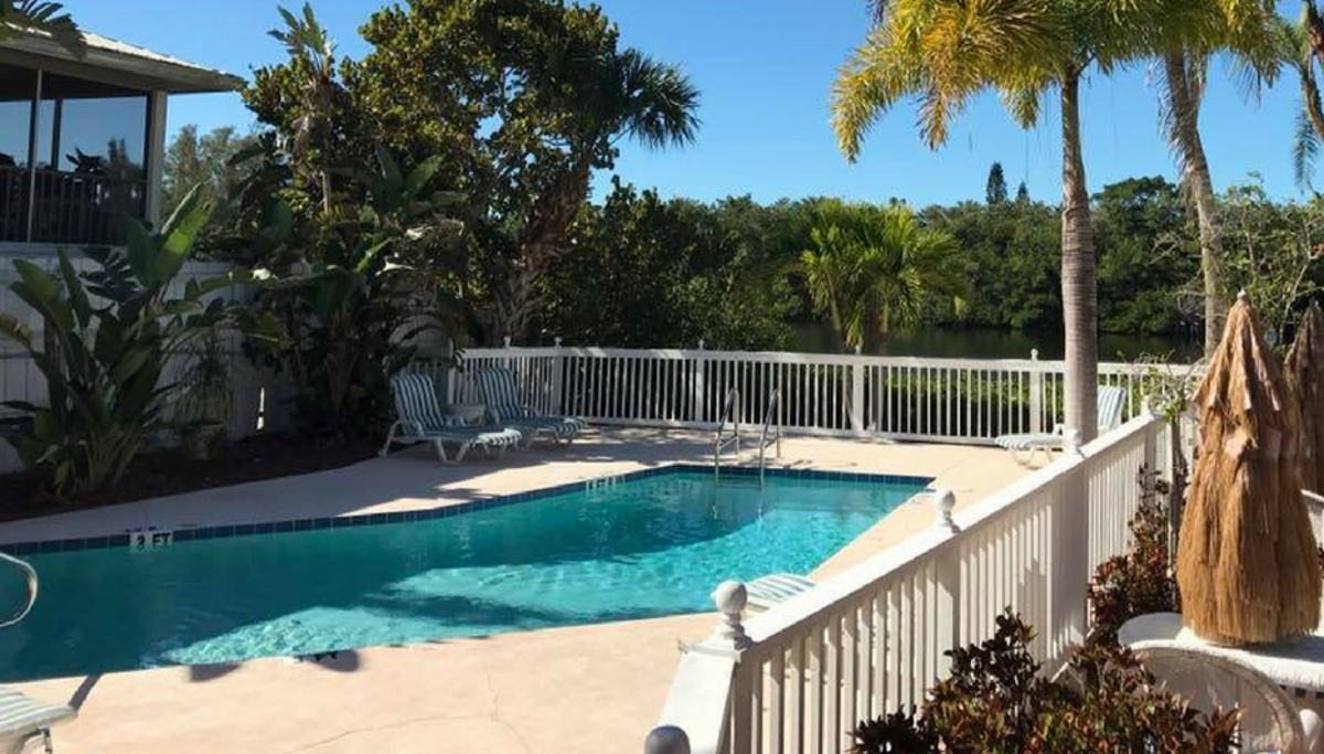 Pool area at Siesta Key Bungalows featuring the outdoor pool
