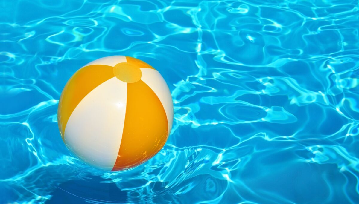 View up close of a Beach Ball floating in the pool at Siesta Key Bungalows