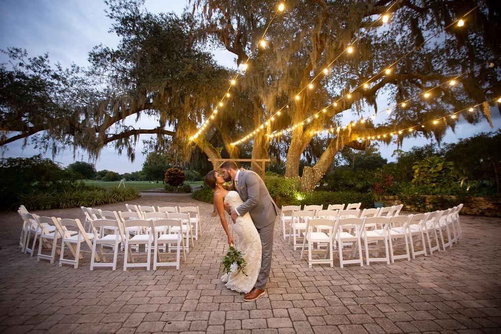 orlando wedding venue - dubsdread catering - couple kissing ceremony