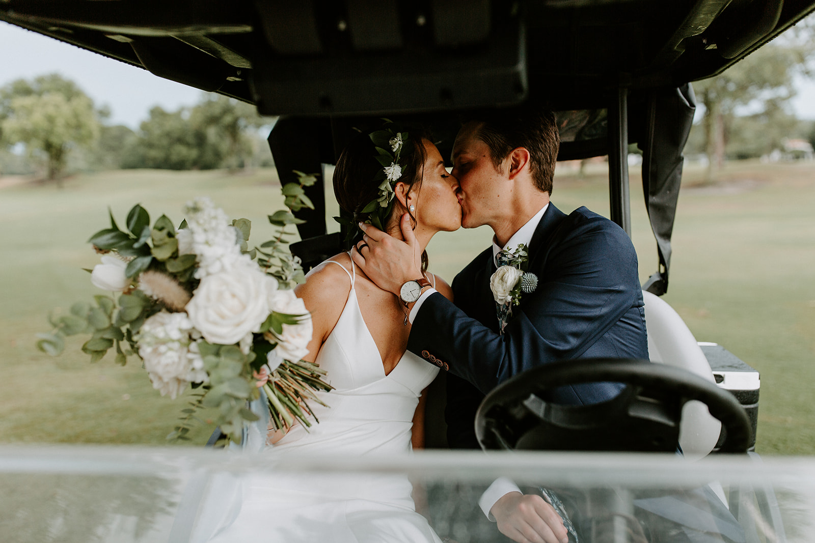 orlando wedding venue - dubsdread catering - couple kissing golf cart