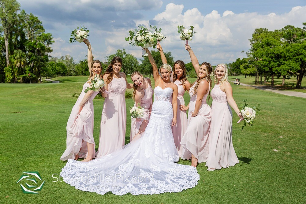 bride and bridesmaids on golf course steven miller photography