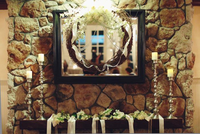 decorative wreath on mirror at wedding reception