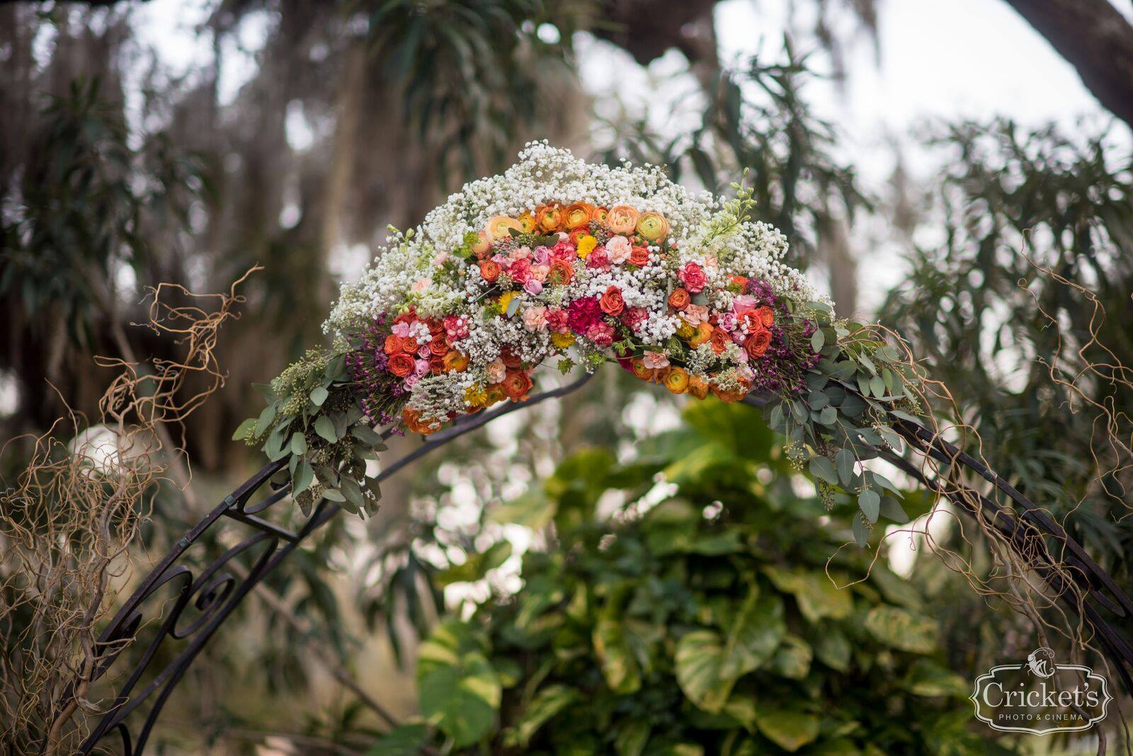 decorative flowers on wedding arch