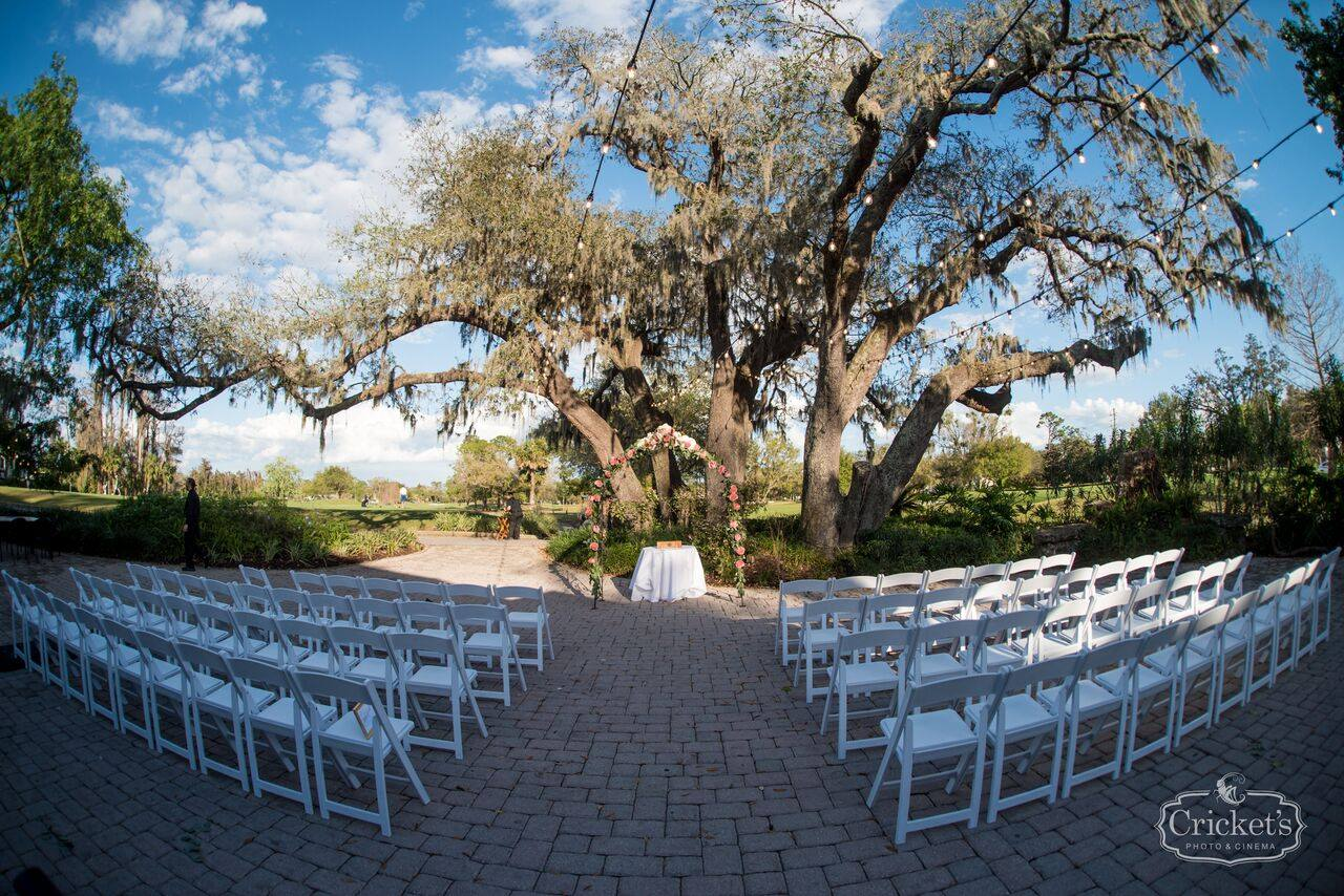 ceremony seating under a large oak tree