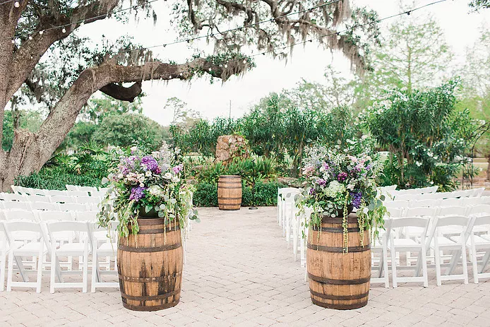 wine barrels framing the beginning of wedding walkway