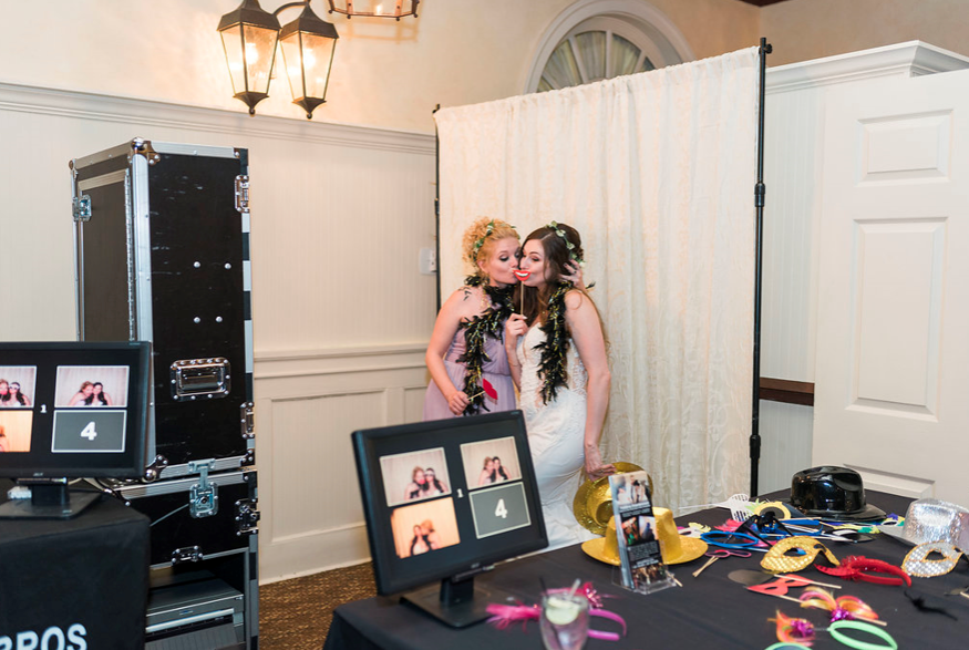 bride and bridesmaid posing in photobooth