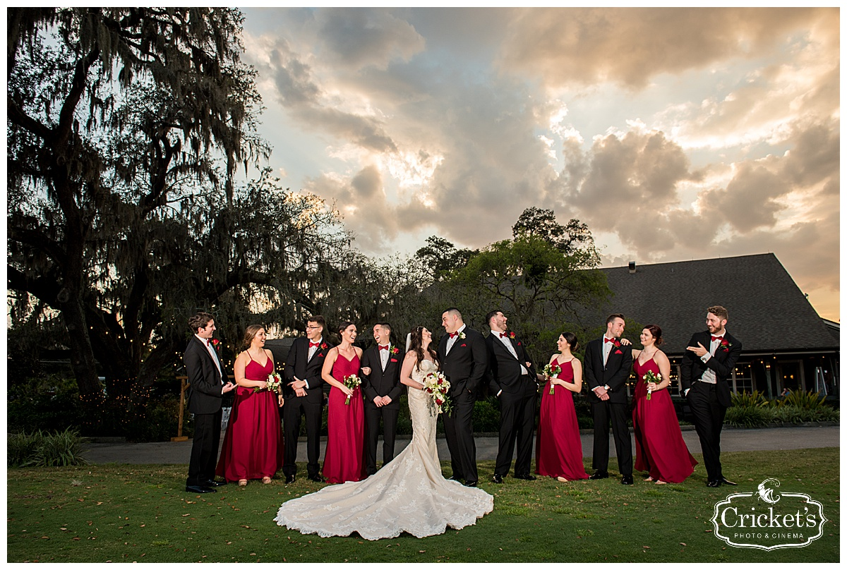 red, black, and white wedding party posing outside
