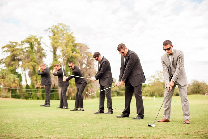 groom and groomsmen posing with golf clubs