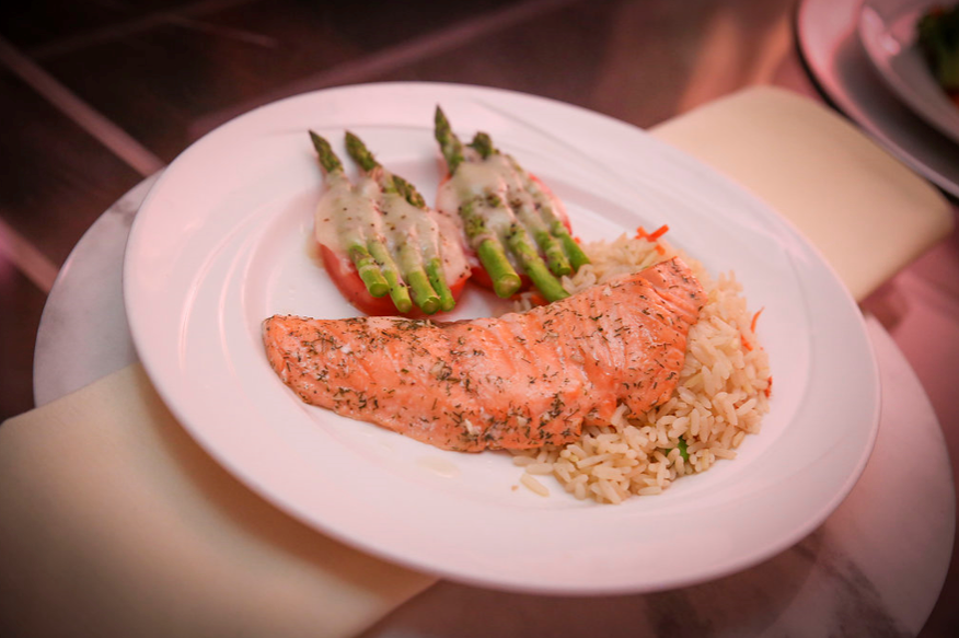 salmon, rice, asparagus, and tomato