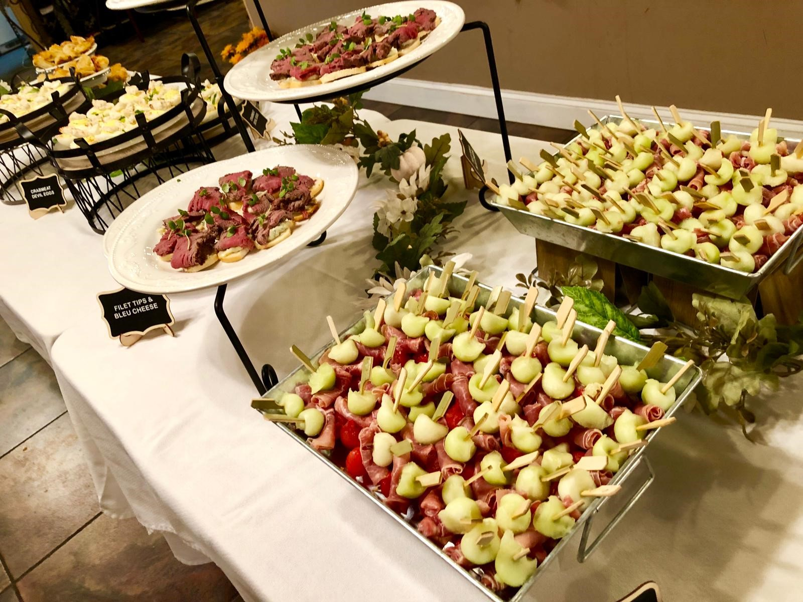 assorted foods on the buffet