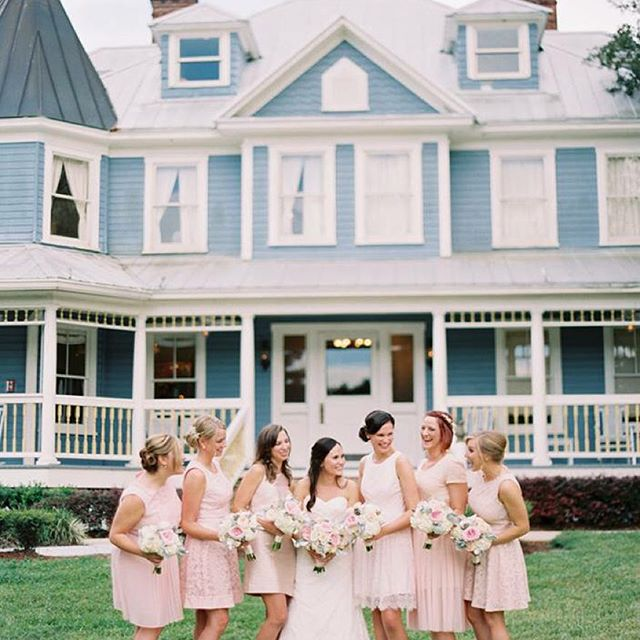 bride and bridesmaids posing in front of highland manor