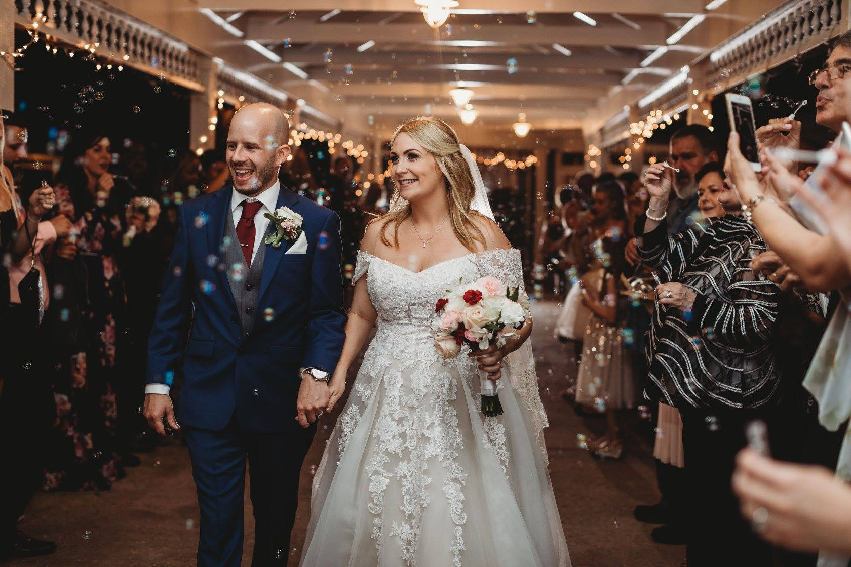 bride and groom leaving reception