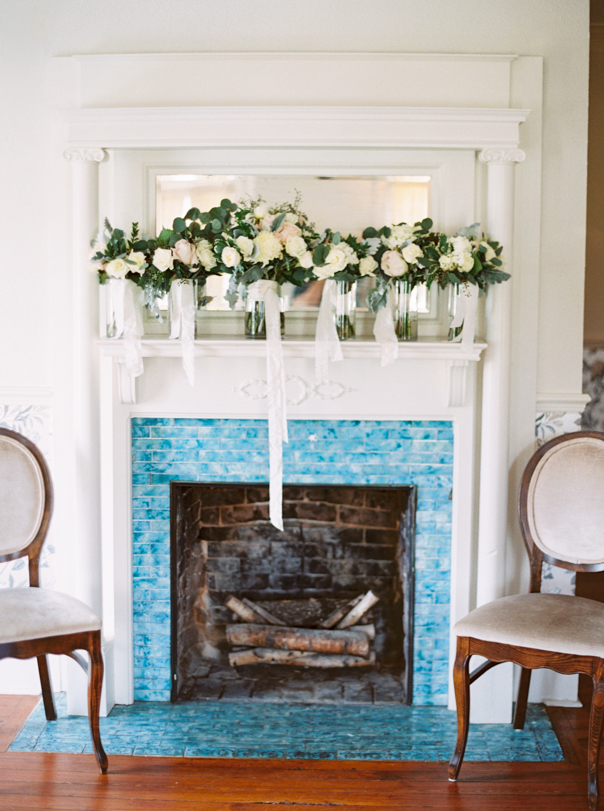 wedding decor on mantel above fireplace