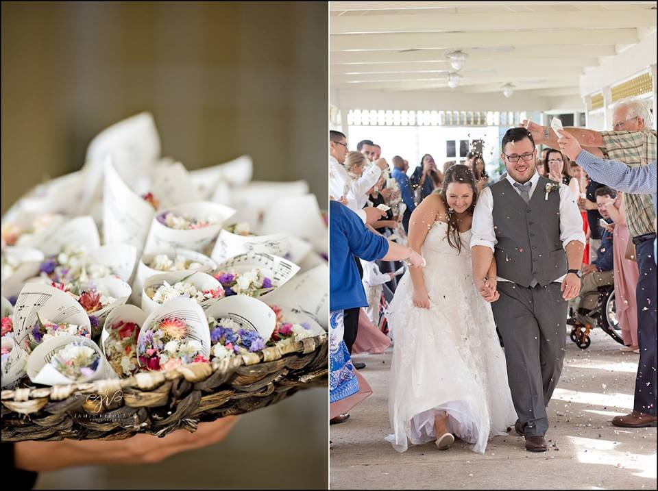 bride and groom showered with tiny flowers during their grand exit