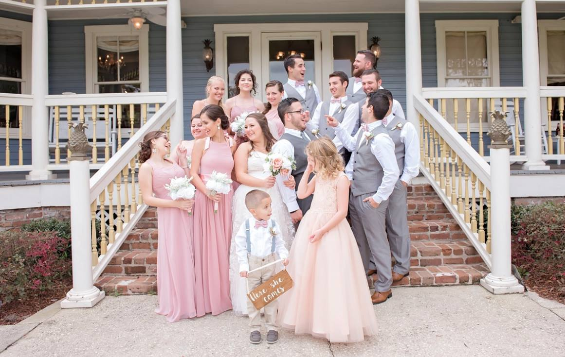 wedding party on highland manor steps