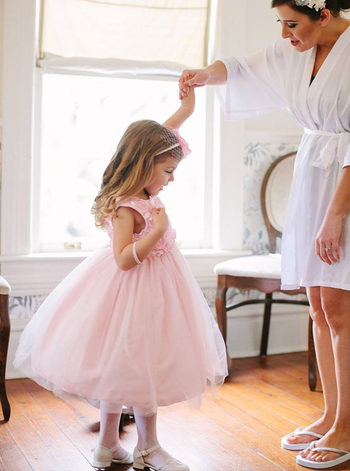 Bride holding hand of small child