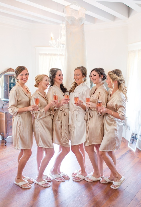 Bride and bridesmaids wearing robes in the bridal suite