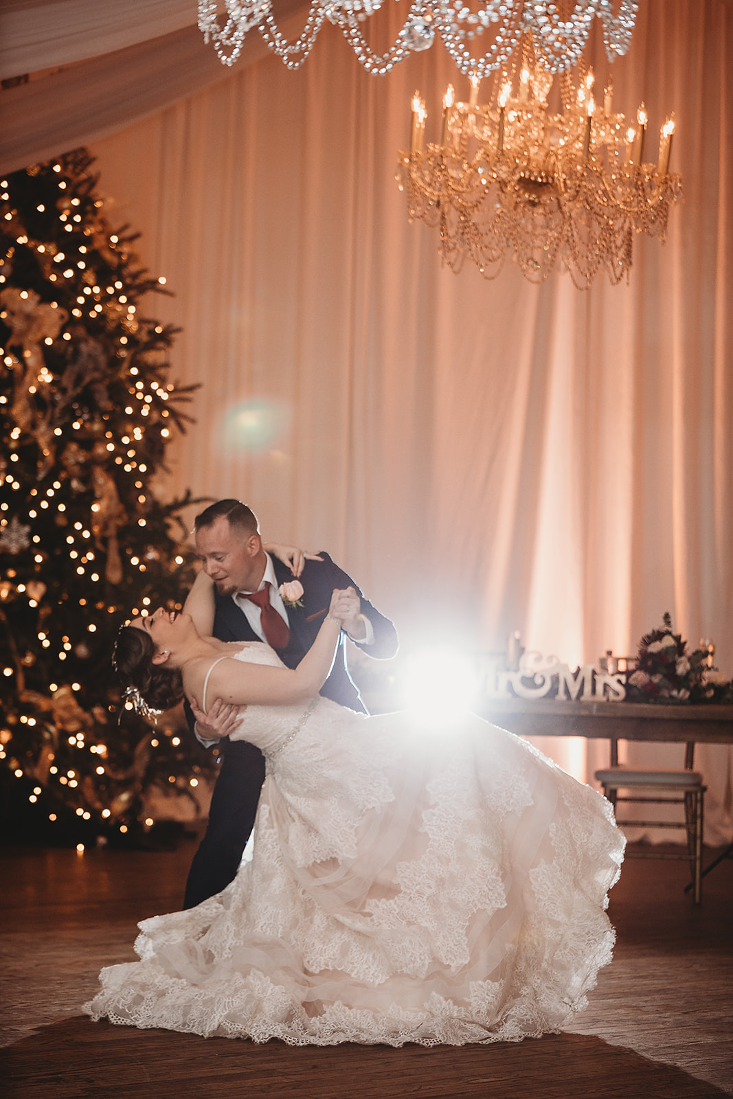 bride and groom dancing in ballroom
