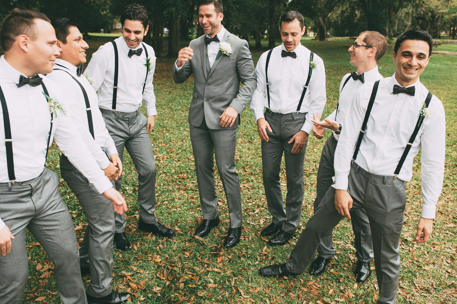 groom and groomsmen posing outside
