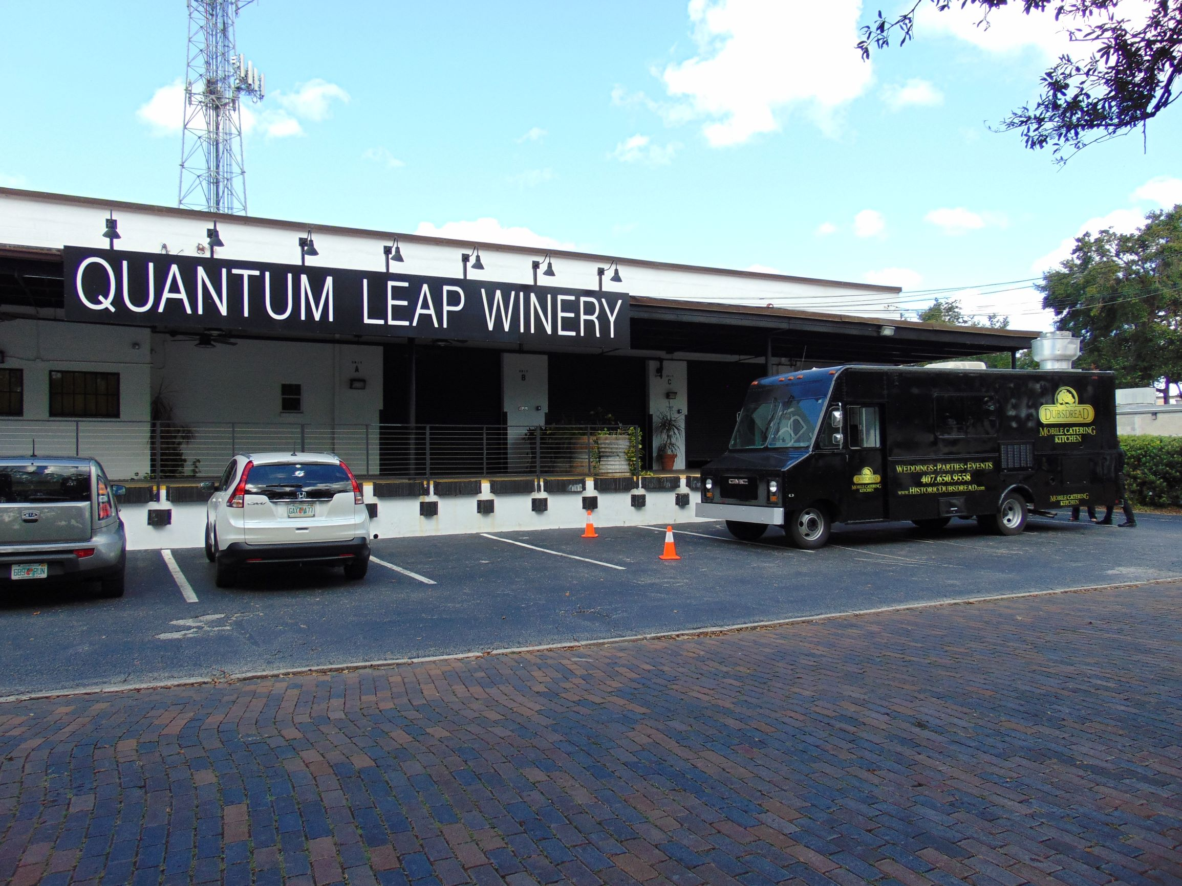 wide shot of food truck in front of quantum leap winery