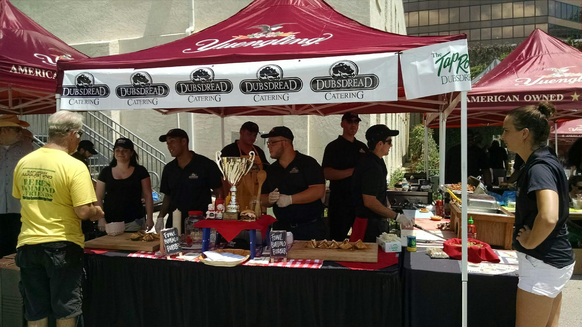 dubsdread catering crew under canopy at the burger bash