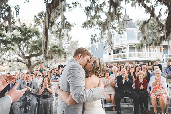 a couple kissing at their wedding