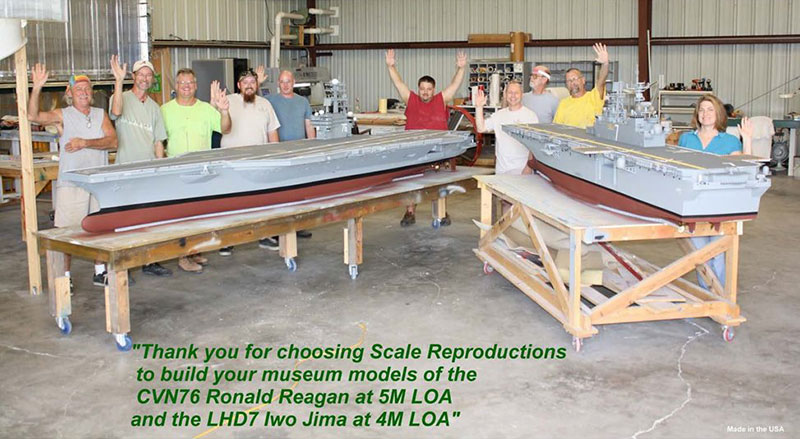 Built to Scale (fka Scale Reproductions) team standing behind two model ships in workshop