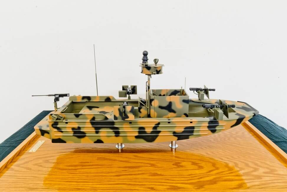 camouflage military boat