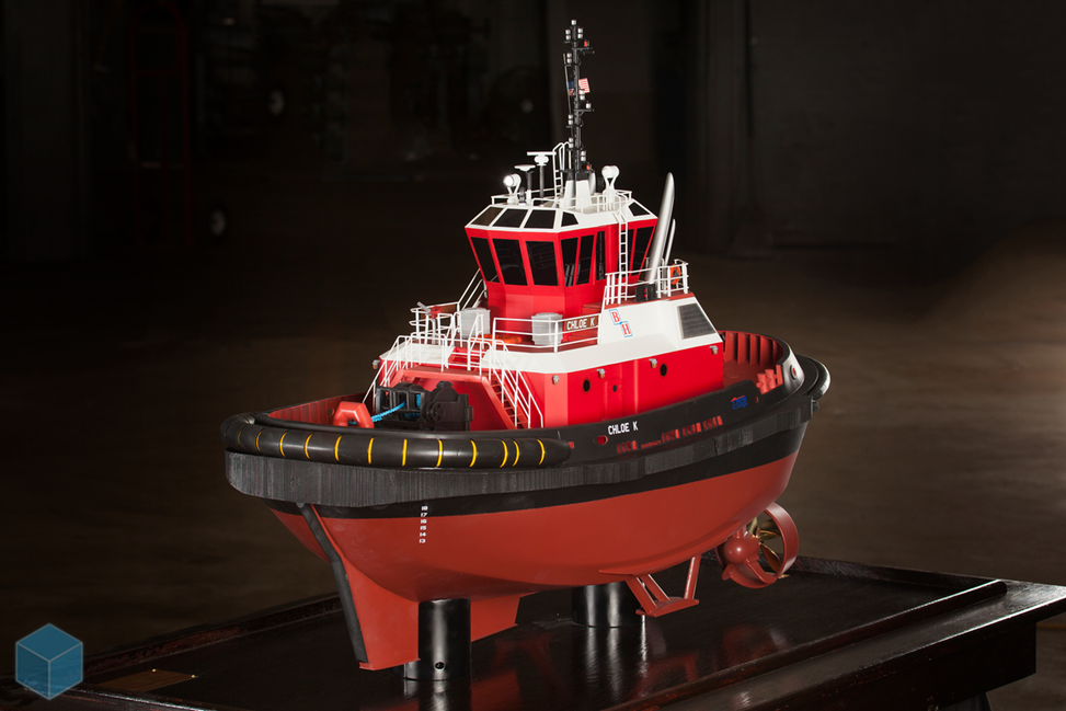 scale model of red and black ship
