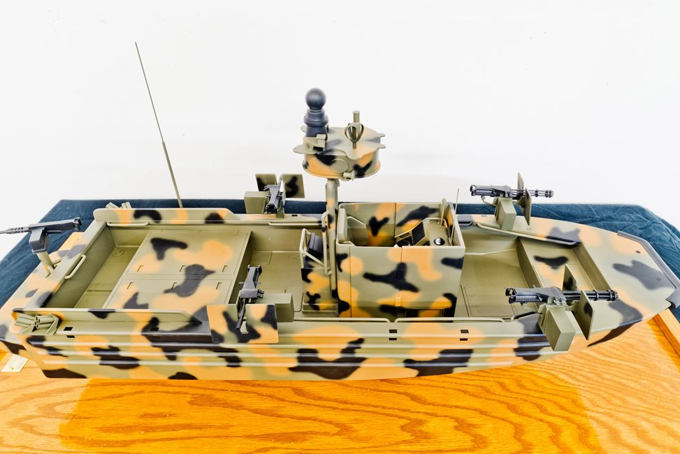 scale model of camoflauge military watercraft