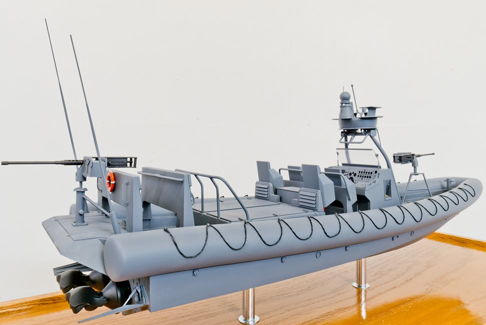 scale model of gray boat