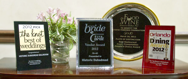 group of wedding venue awards on a table