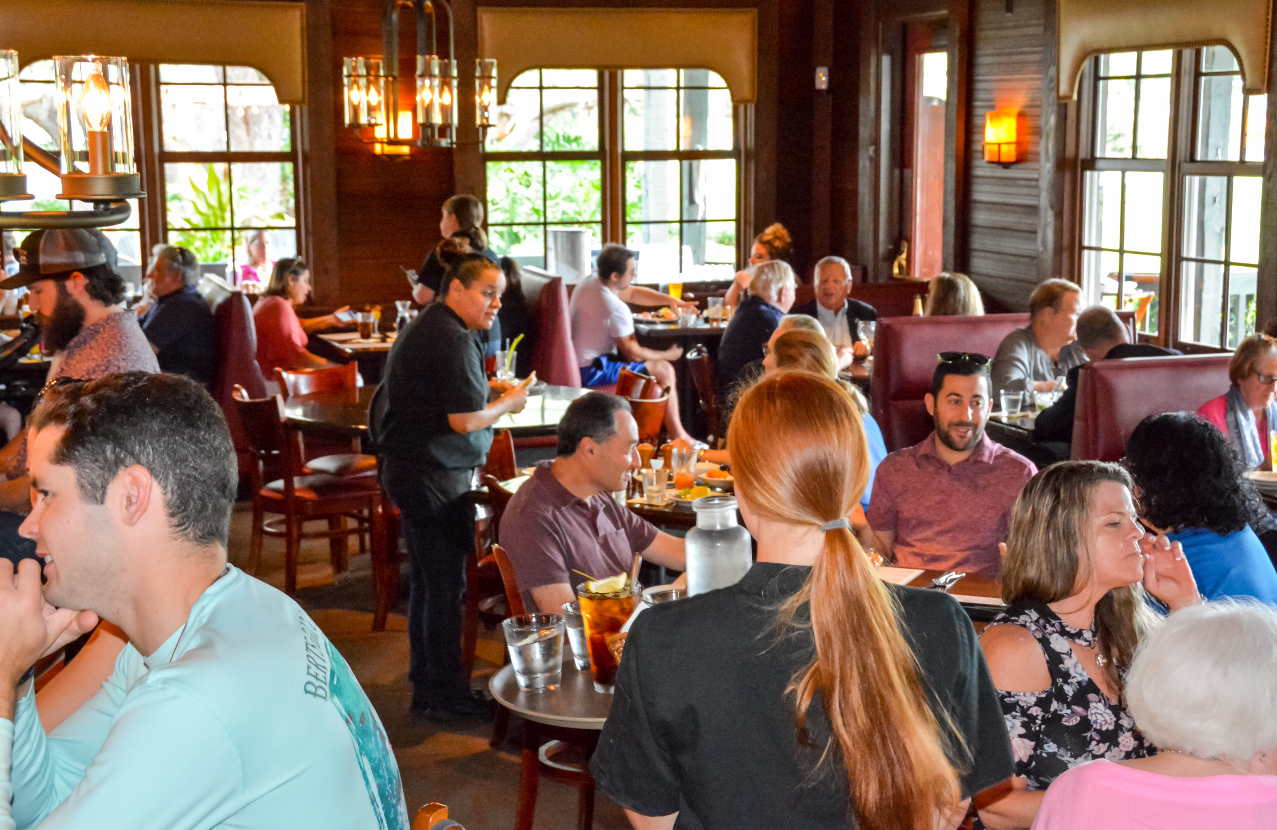 Wide shot of guests enjoying the taproom