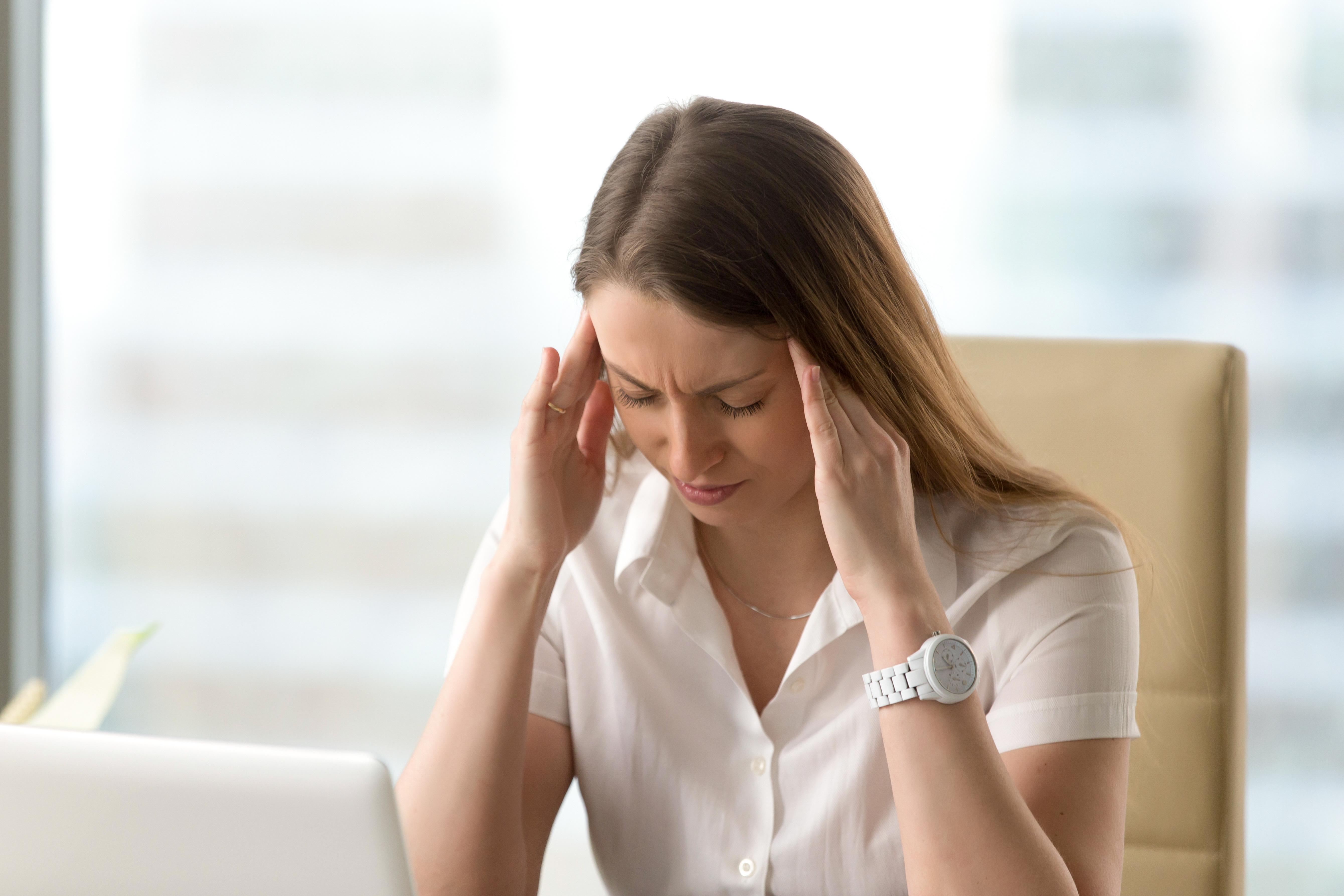 Woman experiencing headache